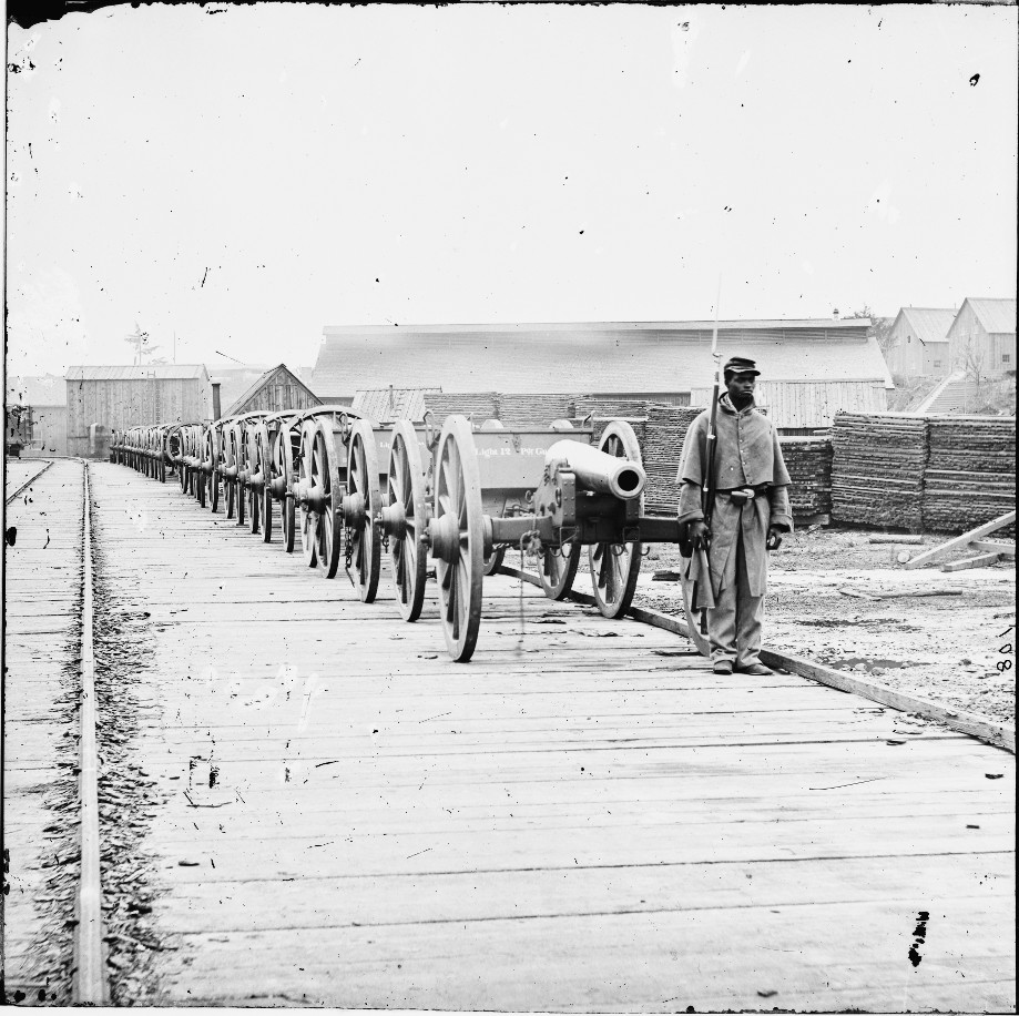 City Point, Virginia. Black soldier guarding 12-pdr. Napoleon.  Photo: Library of Congress